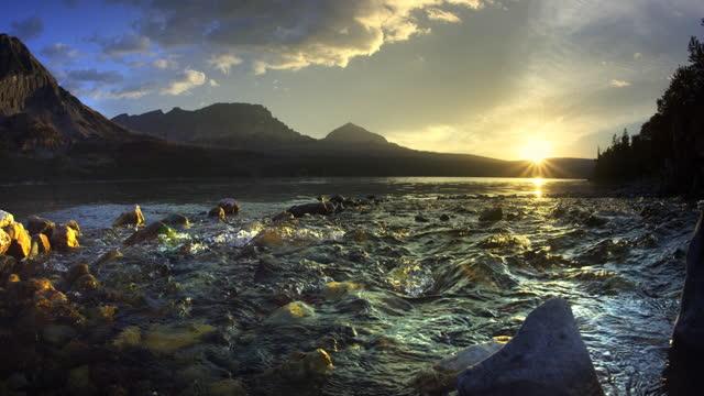 stream flowing into lake at sunrise - splashing stock videos & royalty-free footage