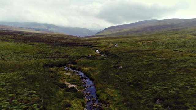stream flowing to sally gap in wicklow ireland, aerial view - bog stock videos & royalty-free footage