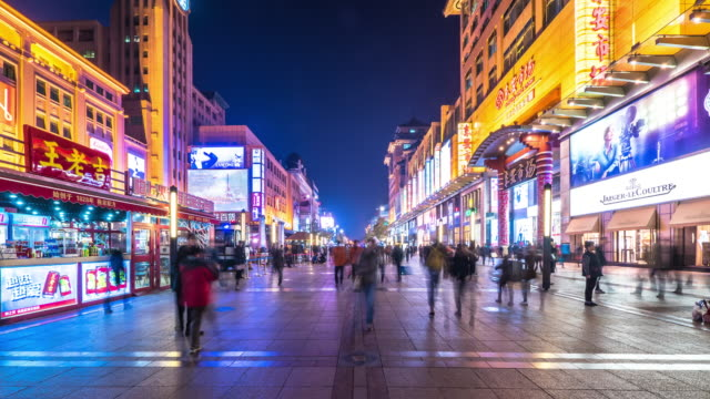 stream of people on busy shopping street time-lapse hyperlapse 4k