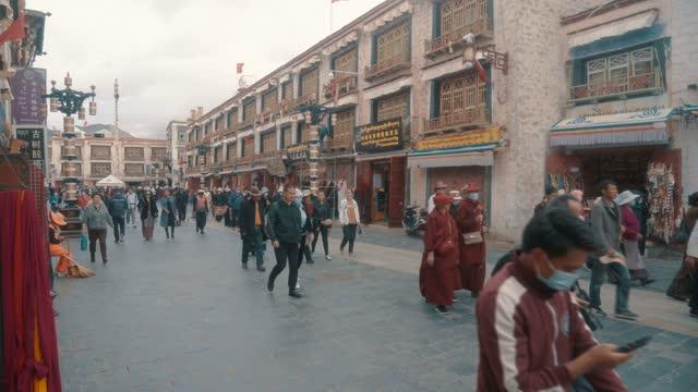 stream through bakuo street, lhasa, tibet, china - traditionally tibetan stock videos & royalty-free footage