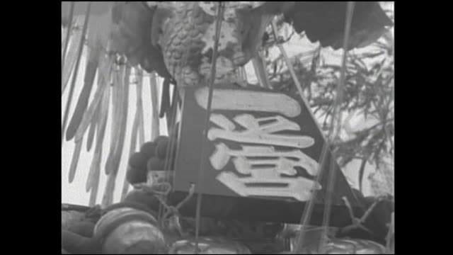 streamers on the funatogyo of asakusa shrine flutter in the wind. - shrine stock videos and b-roll footage