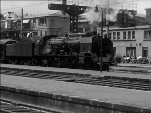 ms pan streamline trains going in and out of station / paris, paris, france - steam train stock videos & royalty-free footage