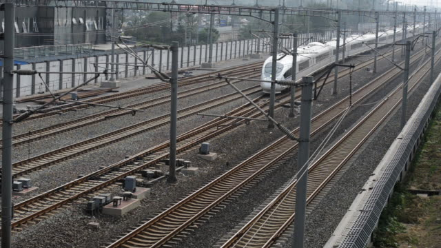 Streamlined CRH train speeding on track, Beijing, China