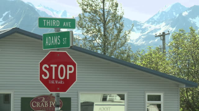 """street and 'stop' sign outside the crab pot grill on corner of 3rd avenue and adams street, 'stop' sign has 'the wars' spraypainted below 'stop', seward, kenai peninsula, alaska."" - octagon stock videos and b-roll footage"