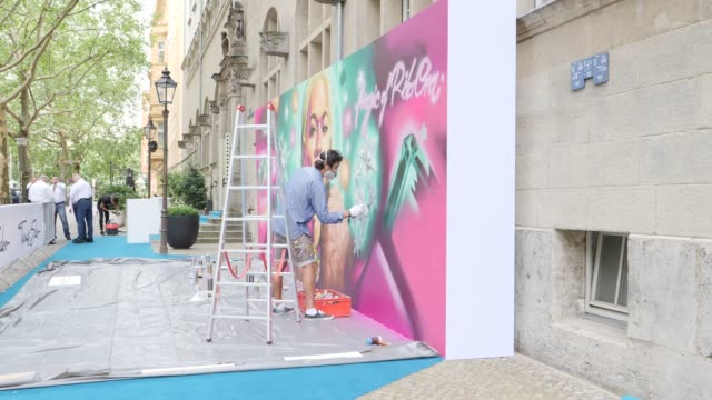 a street art artist sprays a graffiti with the portrait of rita ora for the red carpet event before the thomas sabo x rita ora press cocktail during... - artist stock videos & royalty-free footage