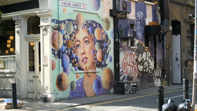 street art by jimmy c in shoreditch, london - handsome people stock videos & royalty-free footage
