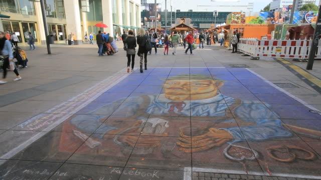 Street art- Chalk drawings on sidewalk at Alexanderplatz