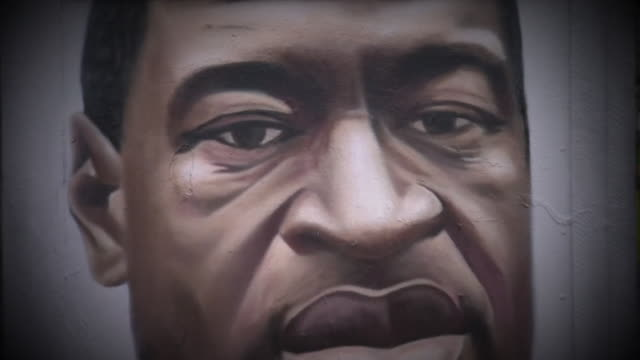 street art depicting george floyd in manchester - mural stock videos & royalty-free footage