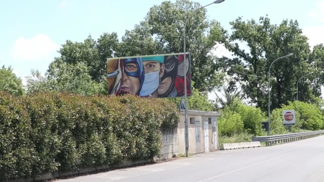 street art work dedicated to nurses compares them to marvel super heroes on may 12, 2020 in cassina de' pecchi milan, italy. italy continues its... - held stock-videos und b-roll-filmmaterial