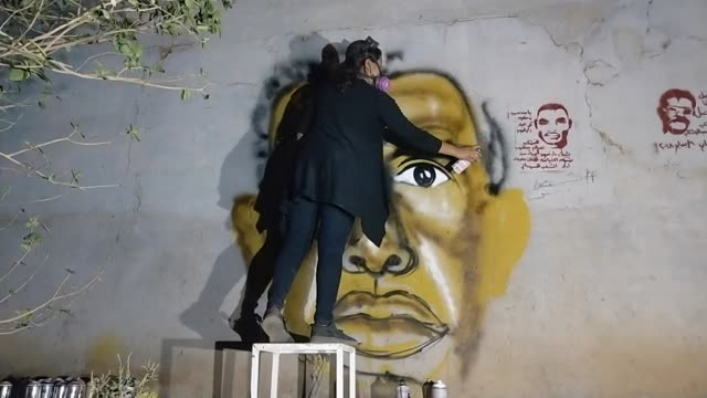 a street artist in khartoum sudan painting the face of a detained protester onto a wall - spray painting stock videos & royalty-free footage