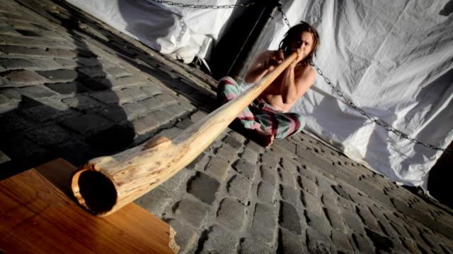 Street artist playing didgeridoo
