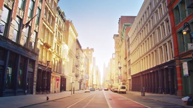 street at soho residential district. urban city. sunlight in the end of street between buildings. - narrow stock videos & royalty-free footage