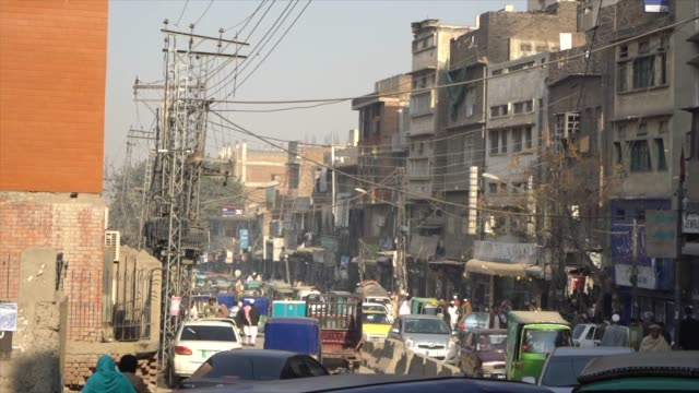 a street at the ander sher bazaar, peshawar, pakistan - pakistan stock videos & royalty-free footage