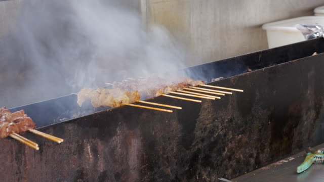 street barbecue grill in flushing, queens, new york - flushing queens stock videos and b-roll footage