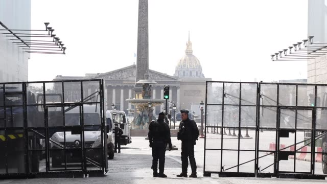 street blocked by police vehicles with grids place de la concorde and the national assembly in the background - british aerospace concorde stock videos and b-roll footage