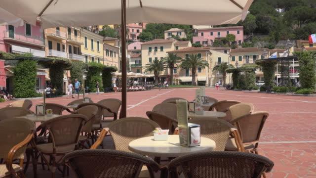 street cafe on piazza matteotti in porto azzurro - island of elba stock videos & royalty-free footage