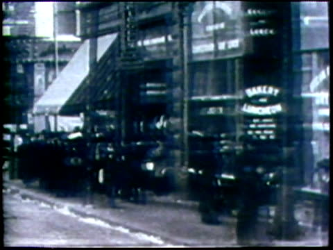 stockvideo's en b-roll-footage met 1973 b/w ws pov street car passing pedestrians and shops on busy street/ usa/ audio - winkelbord