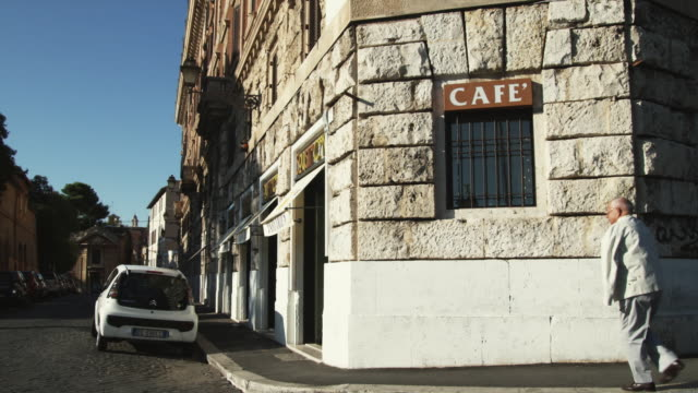 ms pan street corner architecture / rome, italy - western script stock videos & royalty-free footage