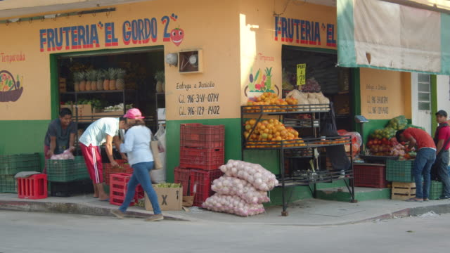 street corner fruit store in downtown palenque, mexico - corner stock videos & royalty-free footage