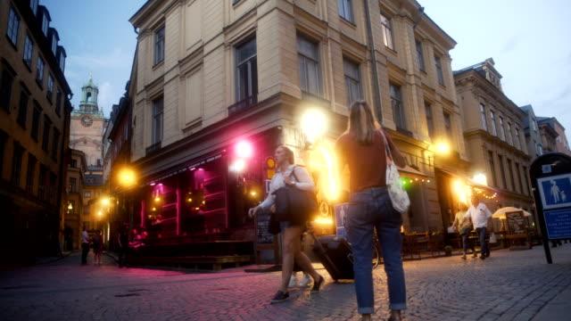 street corner in beautiful stockholm sweden - nattliv bildbanksvideor och videomaterial från bakom kulisserna