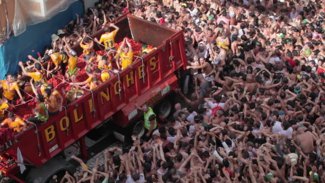 """street crowded of people throwing tomatoes to each other during the tomatina at buì±ol, valencia, spain."" - spain stock videos & royalty-free footage"