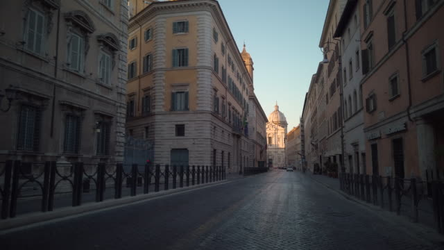 street ending with sant'andrea della valle basilica in rome, italy - italy stock videos & royalty-free footage