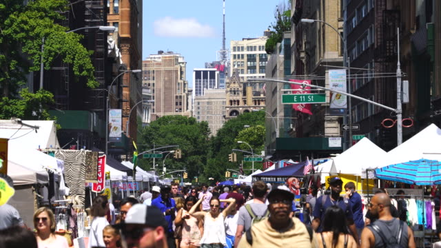 street fair was opened on broadway between union square and waverly place manhattan new york on aug. 13 2017. people walk down among the many shopping booths and food venders along the both side of broadway. - union square new york city stock videos and b-roll footage