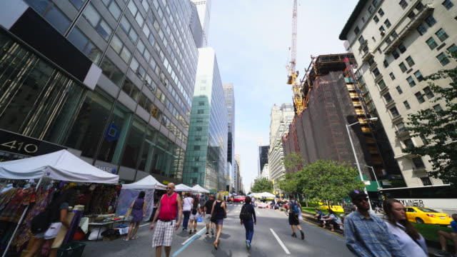 Street Fair was opened on Park Avenue between 45th street and 57th street Midtown Manhattan New York on Aug. 27 2017. People walk down among the many shopping booths and food venders along the Park Avenue.