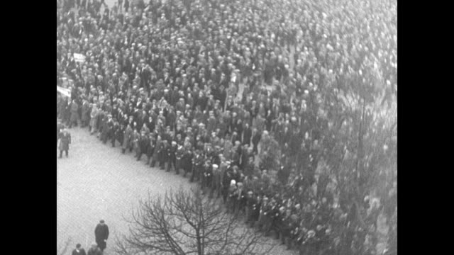 street filled w/ people walking forward night people celebrating holding sparklers press people gathered around president of the council gaston... - 1934 bildbanksvideor och videomaterial från bakom kulisserna