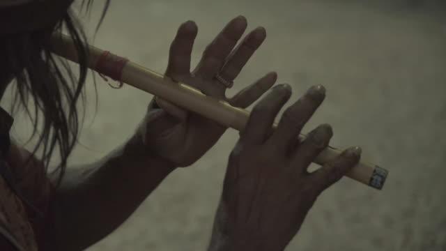 C/U street flute player, India
