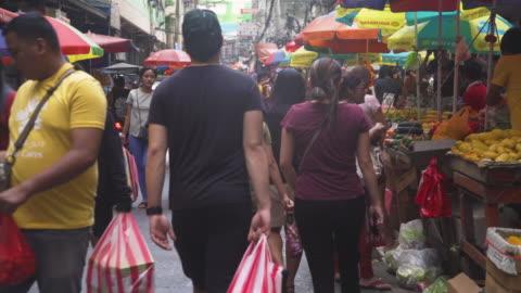street food at divisoria market at manila, philippines - plastic bag stock videos & royalty-free footage
