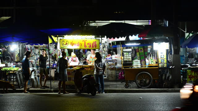 street food carts line up at night near market in chiang saen - thai food stock videos & royalty-free footage