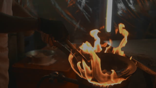 street food : chef with flaming stir fry - hob stock videos & royalty-free footage