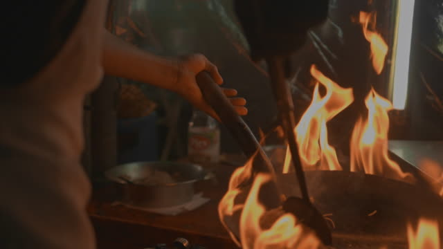 street food : chef with flaming stir fry - bangkok stock videos & royalty-free footage