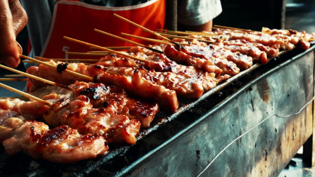 street food in thailand , pork grilled - kebab stock videos and b-roll footage