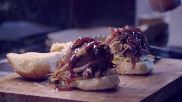 street food pulled pork burger - street food stock videos & royalty-free footage