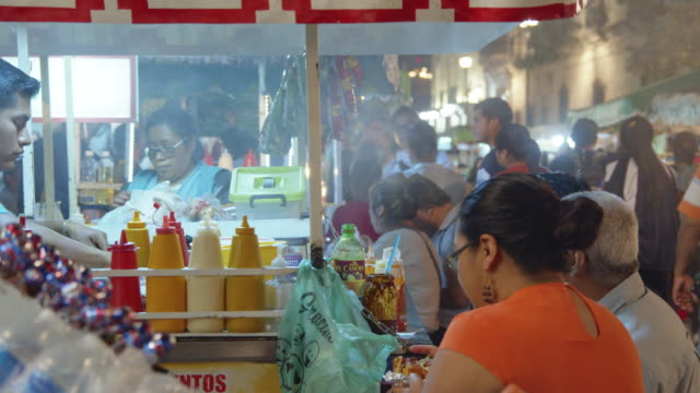 street food stall at a night market in oaxaca, mexico - street market stock videos & royalty-free footage