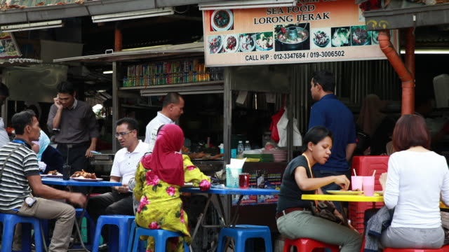 Street food stall with mixed raced customers in midtown kuala lumpur