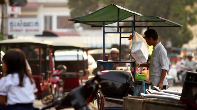 street food vendor in a busy market - cambodia stock videos and b-roll footage