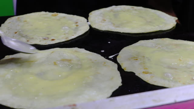street food vendor preparing paratha with egg - savory food stock videos & royalty-free footage