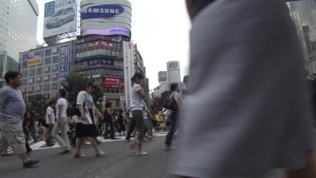 street full of pedestrians - artbeats stock-videos und b-roll-filmmaterial
