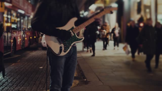 street guitarist playing at night - town stock videos & royalty-free footage