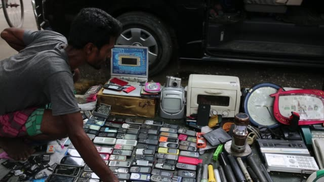 street hawker sells wasted cellphone on street in dhaka bangladesh on july 18 2018 - electrical shop stock videos & royalty-free footage