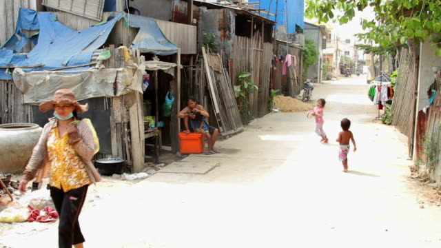 a street in a poor village next to the city dump in phnom penh, cambodia - cambodia stock videos and b-roll footage