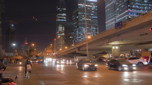 WS Street in city at night, Chaoyang Road, Beijing, China