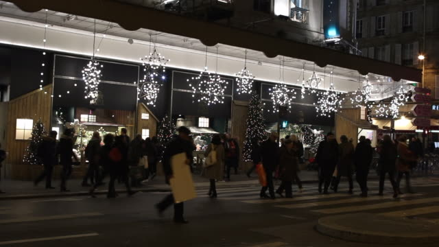 street in front of the department store bhv (bazaar of city hall) with christmas lights - department store stock videos & royalty-free footage
