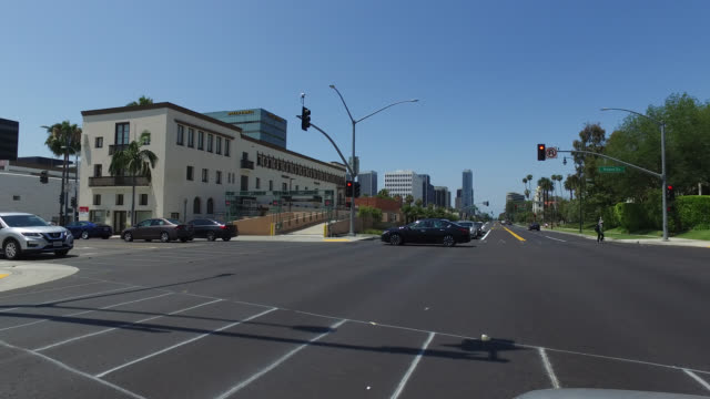 pov of street in los angeles, cars, crossing - santa monica blvd stock videos & royalty-free footage
