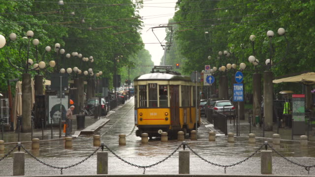 street in milan with tram - milan stock videos & royalty-free footage