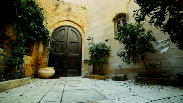 street in old city. architectural background - jaffa stock videos & royalty-free footage