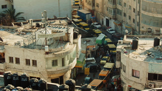 vidéos et rushes de street in ramallah jammed with taxis seen from above - yellow taxi
